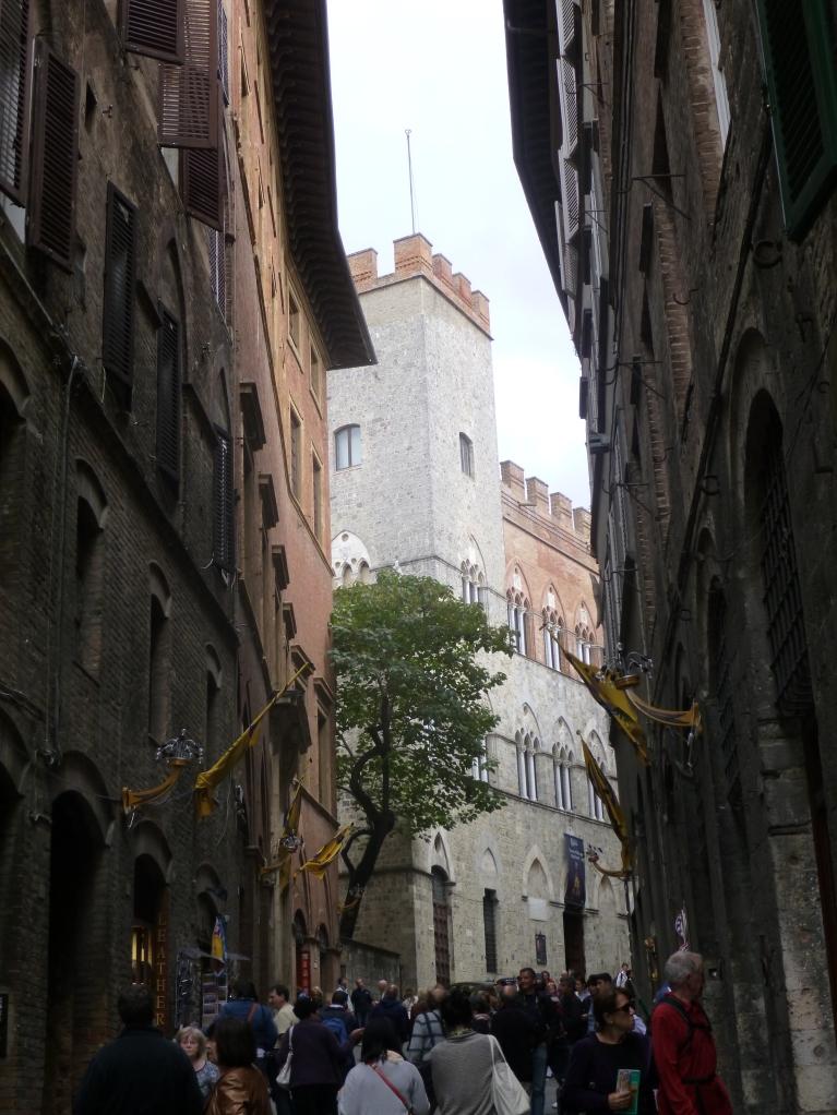 My view walking down a street in Siena