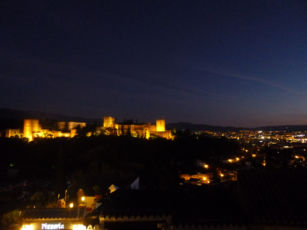 Granada at night, view of the Alhambra on the next hill